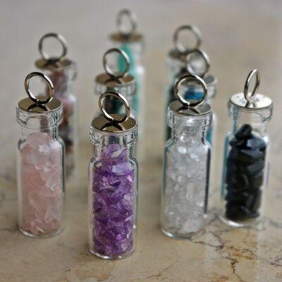 Amulett: apró kövekkel töltött üvegcse